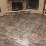 Floors that look like grey wood flooring but are concrete